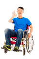 happy young man sitting on a wheelchair and ok gesture over white background - PhotoDune Item for Sale