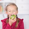Smiling Little Girl Eating Apple At Home - PhotoDune Item for Sale