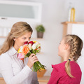 girl giving flowers to mother - PhotoDune Item for Sale
