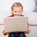 cute little girl looking at laptop - PhotoDune Item for Sale