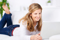 Smiling Woman With Laptop On Sofa - PhotoDune Item for Sale