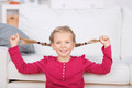 Playful Girl Pulling Her Pigtails At Home - PhotoDune Item for Sale