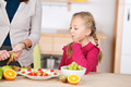 Curious Girl Looking At Fruit Salad In Kitchen - PhotoDune Item for Sale