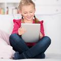 Girl Using Tablet Computer - PhotoDune Item for Sale