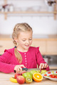 Little Girl Cutting Fruit In the Kitchen - PhotoDune Item for Sale