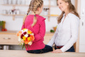 Girl Holding Flowers Behind Her Back By Mother - PhotoDune Item for Sale
