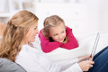 Smiling Mother And Daughter With Laptop At Home - PhotoDune Item for Sale