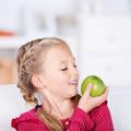 blond schoolgirl holding green fresh apple - PhotoDune Item for Sale
