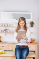 Woman Using Digital Tablet In Kitchen - PhotoDune Item for Sale