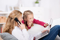 Mother And Daughter With Laptop And Phone - PhotoDune Item for Sale