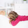 girl lying on sofa looking away - PhotoDune Item for Sale