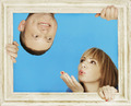 Couple Behind Wooden Frame on Sky Blue Background - PhotoDune Item for Sale