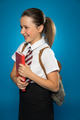 Happy young schoolgirl carrying a tex book - PhotoDune Item for Sale