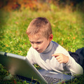 Kid with Laptop outdoor - PhotoDune Item for Sale