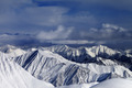 Sunlight snowy mountains and storm clouds - PhotoDune Item for Sale
