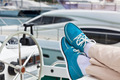 A pair of human legs in pants and bright blue topsiders on yacht - PhotoDune Item for Sale