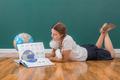 School Girl at a Chalkboard - PhotoDune Item for Sale