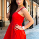 Brunette girl in sexy red dress posing alone in the street. - PhotoDune Item for Sale
