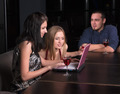 Young attractive people relaxing with laptop and wine in cafe - PhotoDune Item for Sale