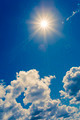 Bright sun on blue sky with clouds - PhotoDune Item for Sale
