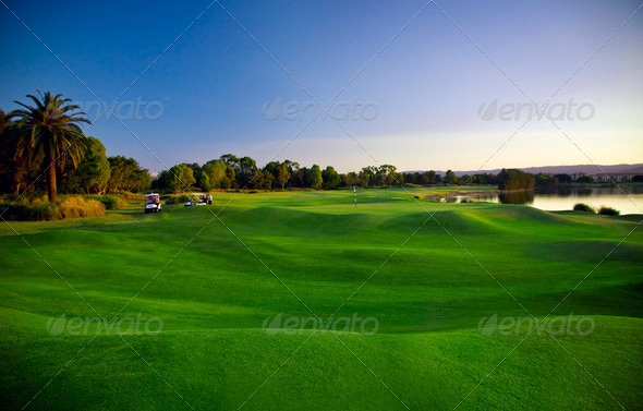 PhotoDune Golf Course and buggies 892598