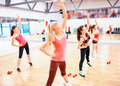 group of smiling women stretching in the gym - PhotoDune Item for Sale