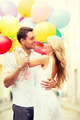 couple with colorful balloons - PhotoDune Item for Sale