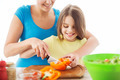 smiling little girl with mother chopping pepper - PhotoDune Item for Sale