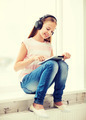 girl with tablet pc and headphones at home - PhotoDune Item for Sale