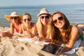 group of smiling young women with tablets on beach - PhotoDune Item for Sale