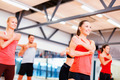 group of smiling people stretching in the gym - PhotoDune Item for Sale
