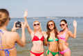 group of smiling women photographing on beach - PhotoDune Item for Sale