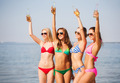 group of smiling young women drinking on beach - PhotoDune Item for Sale