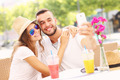 Happy couple taking selfie in a cafe - PhotoDune Item for Sale