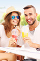 Joyful couple and smoothies in a cafe - PhotoDune Item for Sale