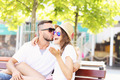 Joyful couple kissing on a bench - PhotoDune Item for Sale