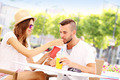 Happy couple drinking smoothies in an outside cafe - PhotoDune Item for Sale