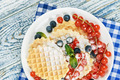 Waffles with fresh berries on the table - PhotoDune Item for Sale