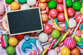 blackboard for writing greetings on a lollipop and sweets - PhotoDune Item for Sale
