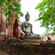 Ancient stone statue of Buddha in ruins of a Buddhist temple. Th - PhotoDune Item for Sale
