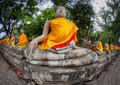 Row of Buddha statues in the old temple. Thailand, Ayutthaya - PhotoDune Item for Sale