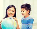 mother and daughter with globe - PhotoDune Item for Sale