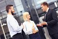 Business people having discussion outside modern building - PhotoDune Item for Sale