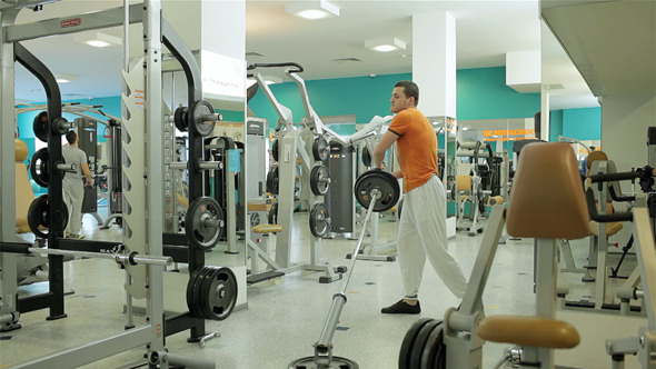 Exercise With Barbell to Develop Chest Muscles
