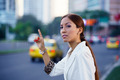 latina businesswoman calling taxi car leaving work - PhotoDune Item for Sale