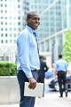 Smiling man standing outside offices building - PhotoDune Item for Sale