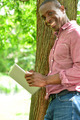 Relaxed smiling man using his digital tablet - PhotoDune Item for Sale