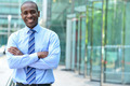 Confident businessman with arms crossed - PhotoDune Item for Sale