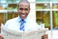 Smiling executive holding newspaper - PhotoDune Item for Sale