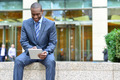 Relaxed businessman using his tablet pc - PhotoDune Item for Sale